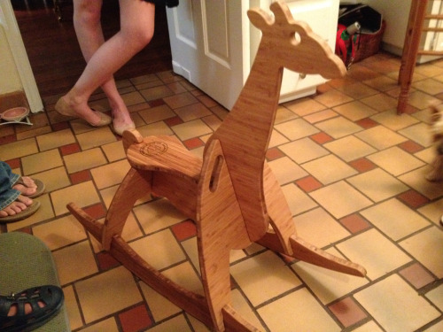 My friends' new line of handmade bamboo rocking animals. This is the giraffe. Isn't it adorable? No nails or glue, just pieced together perfectly and I was even able to ride it! They are called Wee Rock. Website up soon