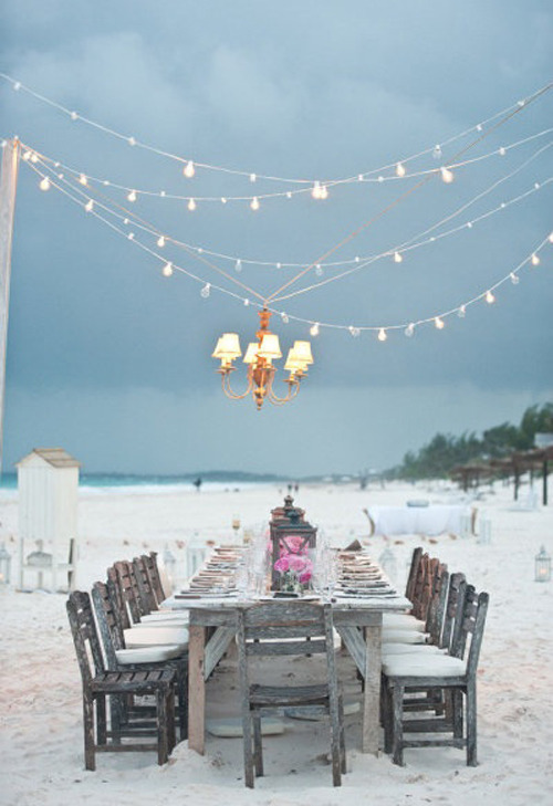 fairy beach dining with a chandelier