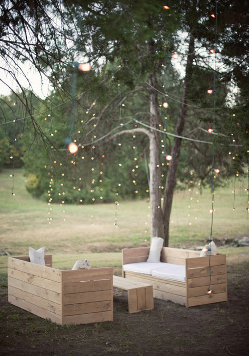 diy wooden living surrounded by fairy lights for a sweet summer party