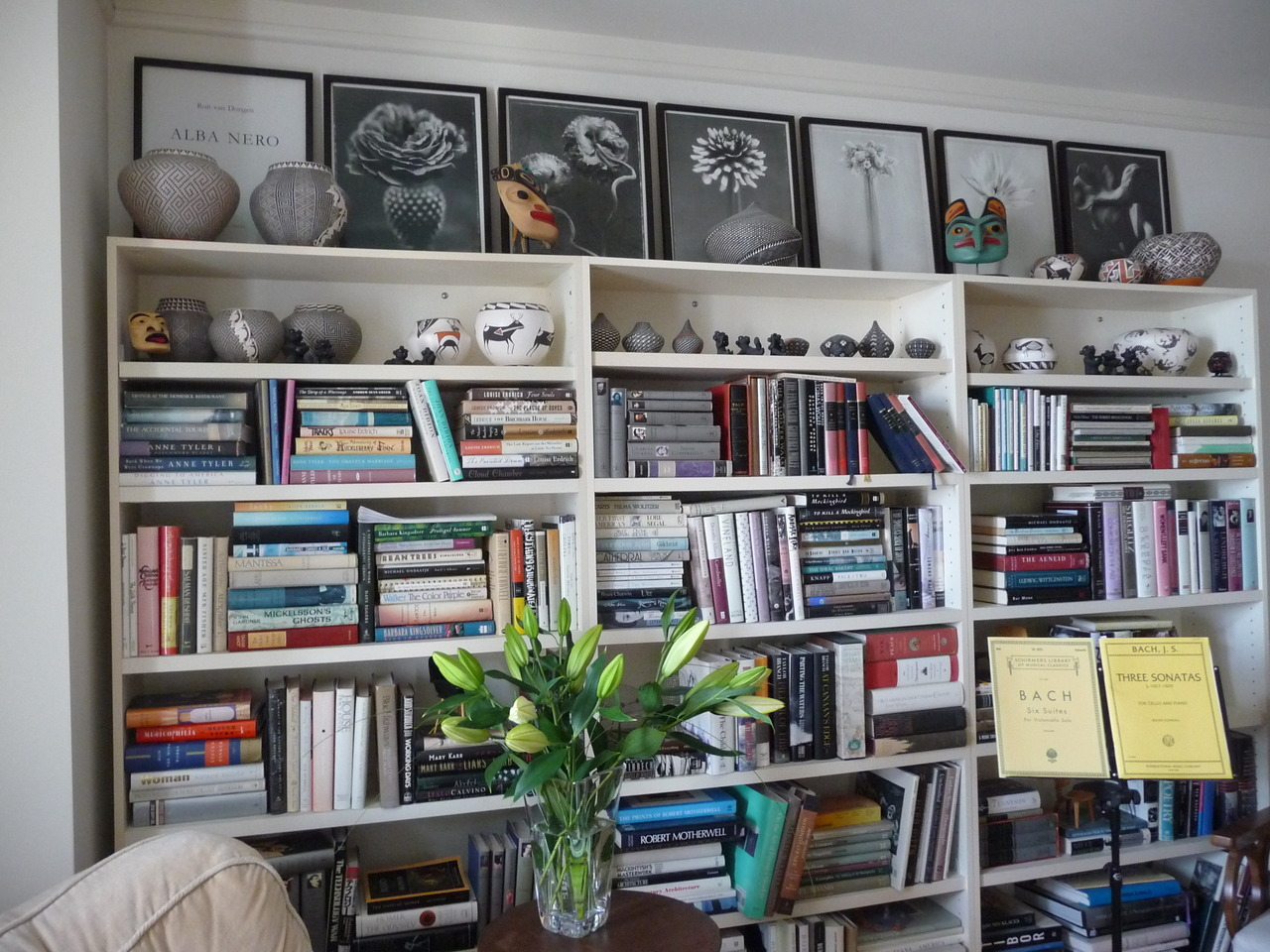 My house in San Francisco: photographs, masks, pots, books, flowers.