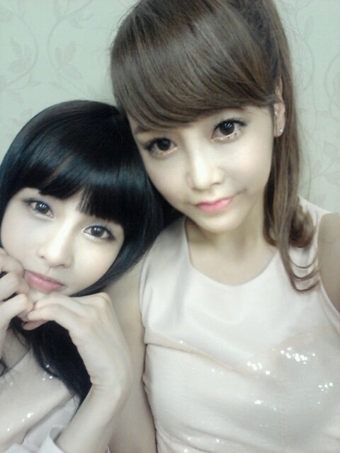 "T-ara's Boram and Soyeon Look Like Dolls in Latest Selca  Though T-ara's latest comeback title ""Day by Day"" is filled with sorrow and angst, group members Soyeon and Boram couldn't look more innocent and sweet in their latest selca! Posted above, the two ladies are splitting images of two dolls in this self-taken photo with their wide eyes and iridescent skin. The brunette and raven are both dressed in matching cream sequined tops, suggesting that this photo was taken backstage during a filming event. If you haven't already, check out T-ara's ""Day By Day"" performance  on Inkigayo from last night and smsoshisushi's review of the album. Do you like the girls' innocent look above or the darker concept from ""Day by Day""? Share your thoughts down!"