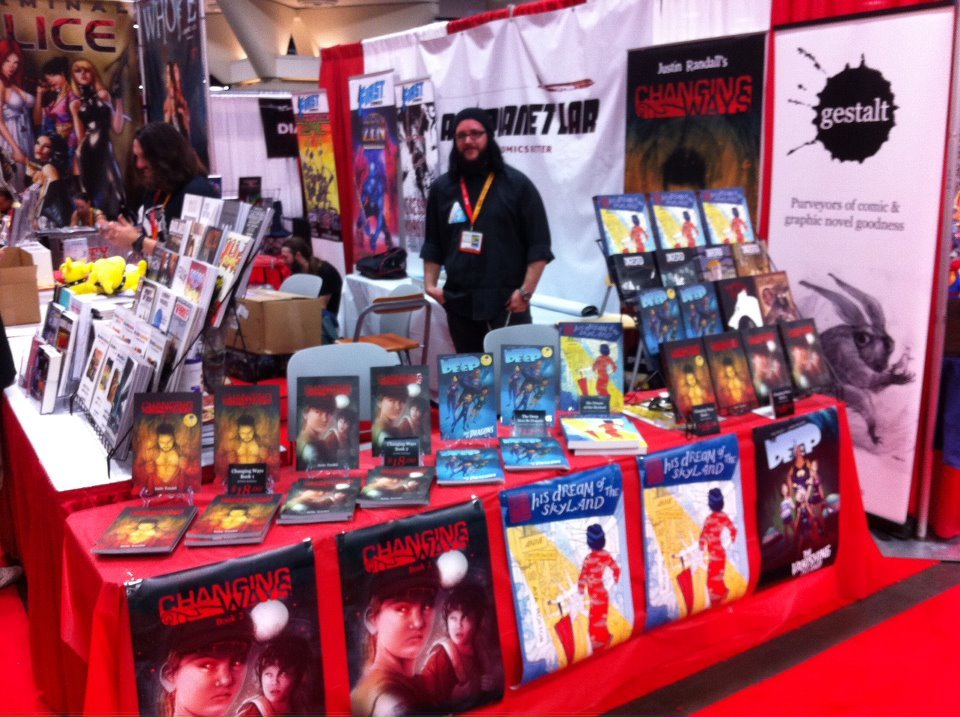 The Gestalt Publishing booth at San Diego Comic Con 2012 with the first book of the Walled City Trilogy by Anne Opotowsky and Aya Morton, 'His Dream of the Skyland'. Hopefully my book will be finished until CC next year. Gestalt on Facebook