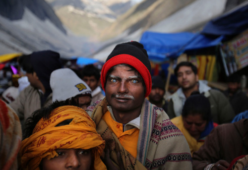 Indian Hindu pilgrims line up to enter the Amarnath cave to view the icy stalagmite representing Shiva, the Hindu god of destruction, June 29, 2012. (Kevin Frayer/Associated Press) (via Amarnath: Journey to the shrine of a Hindu god - The Big Picture - Boston.com)