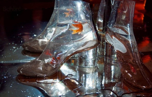 stopdropandvogue:  Margiela Aquarium: clear booties that second as goldfish bowls by Maison Martin Margiela