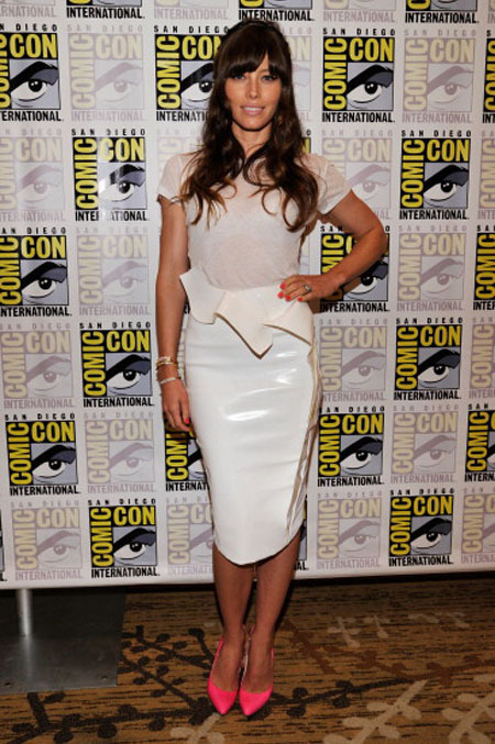 Jessica Biel shilling for Total Recall at Comic Con.  Mugler at Comic Con? Really? Don't get me wrong, I love the skirt, and that asymmetrical peplum is divine, but let's leave Mugler to movie photocalls and lesser red carpet events. Besides, pairing it with a super thin Joe's Jeans tee and Brian Atwood's 1989 inspired video vam pumps shows that you're clearly trying way, way, too hard for this event. You put a lot of (unnecessary) effort into this ensemble and clearly ran out of steam when you got to that mop of a hairstyle. Helmet bangs and fluffy blanket hair is not a good look. Not even on you. My advice for next time is to call Kristen Stewart to find out how it's done. Image credit: Getty