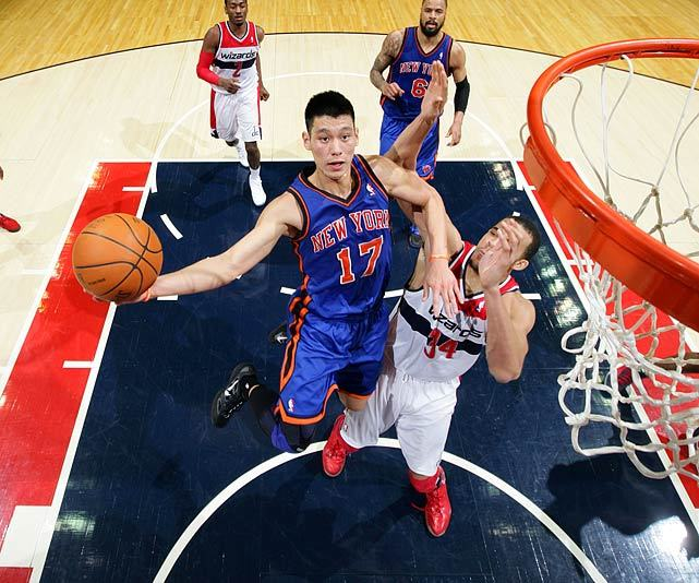 Jeremy Lin drives to the hoop during a 2012 Knicks-Wizards game. Houston signed Lin to a three-year, $25.1 million offer sheet over the weekend and New York has until 11:59 p.m. on Tuesday to match or lose their popular point guard. SI's Sam Amick writes that Lin is a perfect example of NBA's silly season where players are offered contracts that far exceed their actual value. (Ned Dishman/Getty Images) AMICK: Silliest of summers continues as Rockets, Knicks battle for LinGALLERY: The Jeremy Lin Fan Club | Ivy Leaguers Playing in the NBA