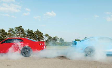 Superpony Comparison Test: 2012 Chevrolet Camaro‬ ZL1 vs. 2013 Ford Mustang‬ Shelby GT500 via Car and Driver