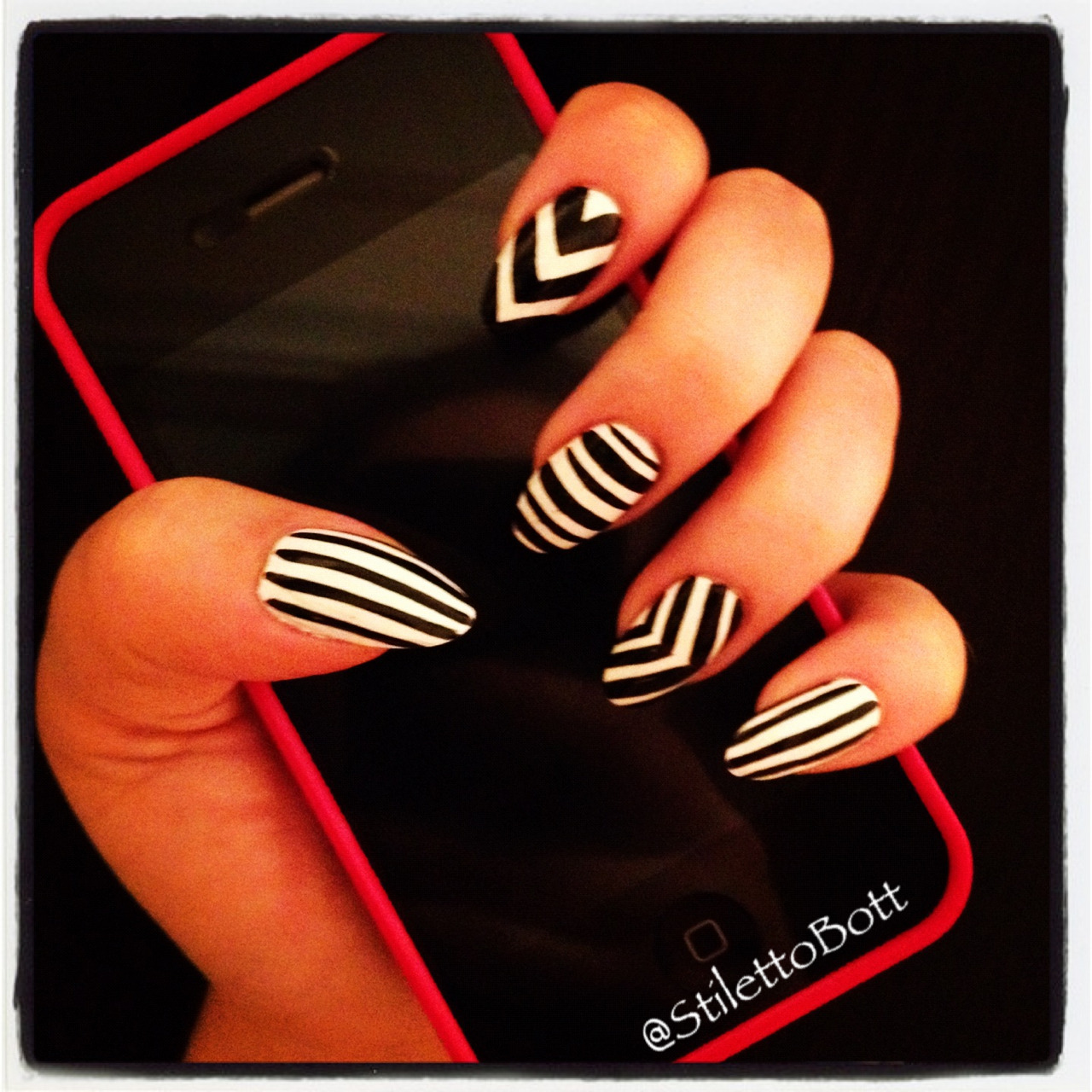 stilettobott:  What's Black & White and Striped all over?