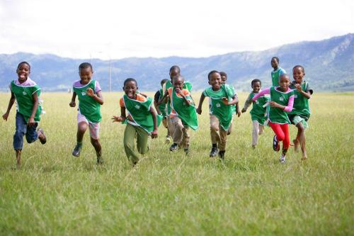 unicef:  Children play in the town of Lobamba in Lobamba Region of Swaziland. They are participating in the UNICEF-sponsored Life Skills through Sport Programme, which uses games to teach children about health and the prevention of HIV/AIDS. © UNICEF/NYHQ2009-2616/Giacomo Pirozzi http://www.unicef.org