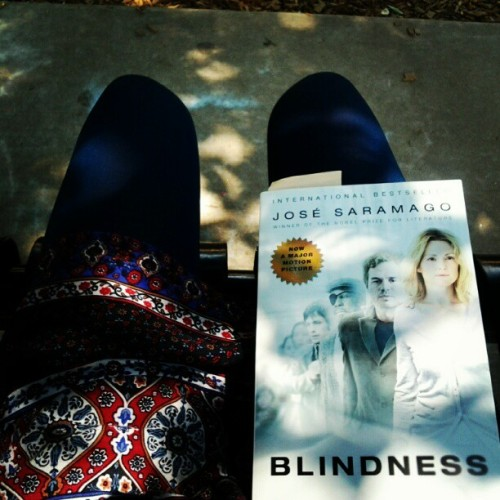 Beautiful day for a read in the park! sycamoresong:  On a bench at Baker Park. #saramago #sunshine #shade (Taken with Instagram)