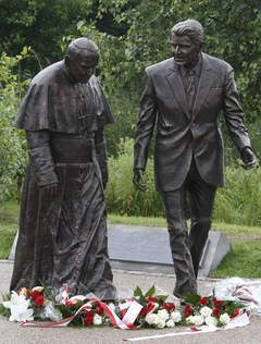 This statue of President Ronald Reagan and Pope John Paul II was unveiled Saturday in Gdansk, Poland. The late leaders are revered in Poland for their role in helping to topple communism. (Czarek Sokolowski - AP)