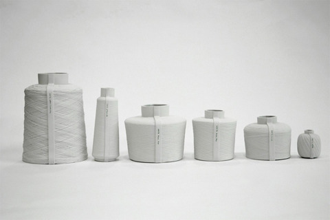 Spool by Mara Skujeniece Porcelain vases cast from spools of yarn.  (Because it's not enough that I have actual yarn in every nook and cranny of my abode.)