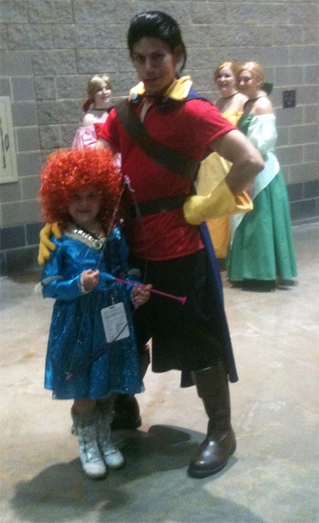 Aeris as Merida with Gaston at ConnectiCon 2012. I love the fangirls in the back. Also this Gaston makes Jackson Rathbone faces.   I would approve of that casting.