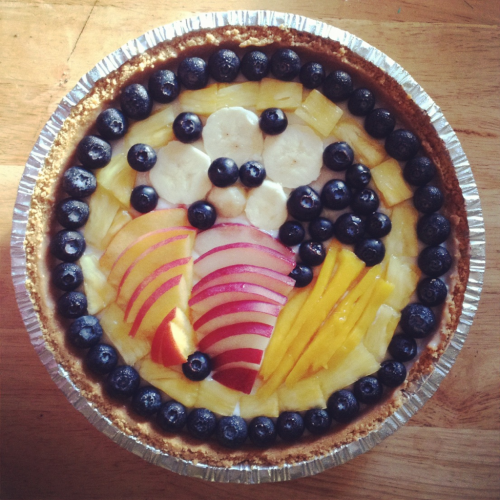 Vegan coconut custard pie in a graham cracker crust with blueberries, pineapple, banana, peach, white peach & mango.