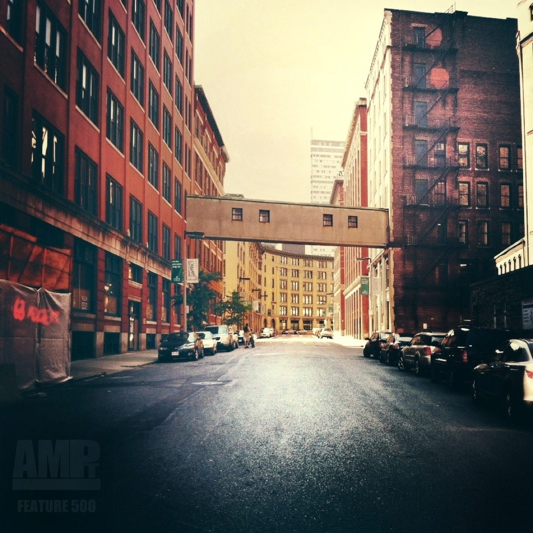 "AMPt FEATURE 500 photo by Ryan O. @x_epic   Description: This street houses phenomenal 19th / early 20th century warehouses with a very dramatic turn at the other end. The light and shadows in the corridor are cool to see at varying sun levels   Process: Shot with Crossprocess. Basic (+green) selected.  Edit: Picfx to crop. Snapseed, use Center Focus at the skyline. Blur at 0%, inner and outer brightness diminished. Apply Drama Filter at 30% strength with Saturation at 50%. I then use several passes of Selective Adjust dodge / burning using brightness/contrast spots to vignette, add shadow or fake highlights on surfaces. Saved to Roll. Open in Picfx and applied the Valentine filter at 30%. Saved to roll and uploaded to IG   Bio: I'm a visual artist. I make small abstract dioramas, fake cities, weird organisms. I got into mobi photography to record my surroundings as ""sketches"" for other projects. Also, to expore the area i live in. IG definitely made that easier. I'm originally from outside Philly, but currently live in Boston, working 2 jobs, paying loans, eating beer and waiting for more vertically prolific cities. My name is Ryan O."