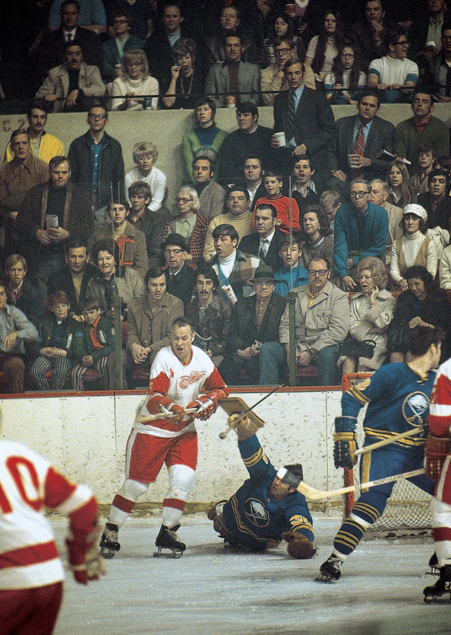 Gordie Howe tries to sneak a shot past Joe Daley during a 1971 Sabres-Red Wings game. (Walter Iooss Jr./SI) GALLERY: All-Time Oldest NHL Players