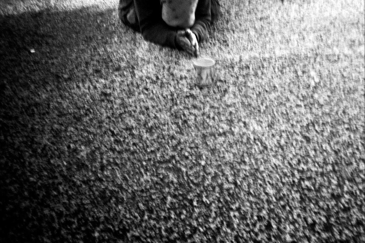 Homeless & Praying.  Rome.   Holga 35mm