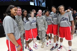 Members of USA Women's Basketball (including the Lynx's Maya Moore, Lindsay Whalen and Seimone Augustus) pause to take a photo with military members. (Photo by Ned Dishman)