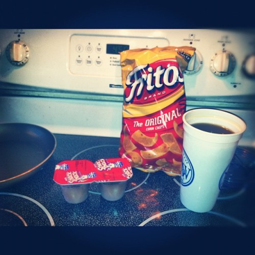 "Tonight's feast: Snack pack and Fritos. The Perfect dinner to say, ""I don't care anymore."" (Taken with Instagram)"