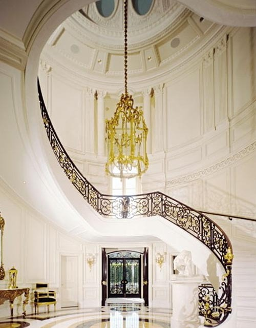 luxury interiors with grand staircase and great chandelier