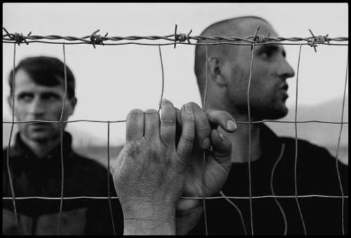 James Nachtwey Albania, 1999 - Kosovar deportees meeting in a refugee camp