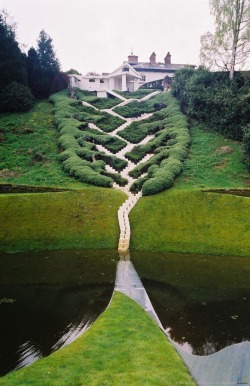 modernations:  Charles Jencks is the American landscape architect and designer behind this incredible flight of stairs. Called The Universe Cascade, it has 25 landings that mark the important shifts in cosmic history. Starting at the top, in the present day, and descending down, visitors are moving through 13 billion years of cosmic evolution. The steps finally disappear into the dark water below, which represents the mystery of the origin of the universe.