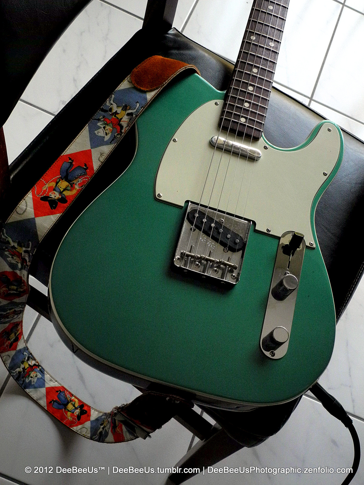 deebeeus:  …and some evenings I just play my Sherwood Green AVRI Custom Telecaster!   I am pleased to say that I have exactly 5 Telecasters…and every single one of them is awesome!  They are (in no particular order): 2000-and-something American Vintage Reissue '62 Custom Tele in Sherwood Green (pictured). 2005 Custom Shop '67 Relic in shoreline gold.  Love this one because it weigh in at a mere 6.8 lbs!  Plus shoreline is such a cool colour!  :D 2009 American Standard FSR, in fiesta red with matching headstock and hand-wound Pickup Wizard pickups. 1998 Custom Shop '60 Custom Tele NOS, in 3 tone sunburst. 2011 Ltd Edition 60th Anniversary Modern Thinline in Olympic White. Maybe I will do a Telecaster-only photo series…hmmm…yeah.  Stay tuned! Toronto, July 16, 2012.