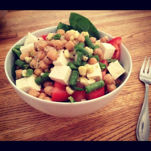 """Summer Thyme""- Green Bean, Corn and Chickpea Salad with Lemon-Thyme Dressing Summer heat brings about the development of some cool dishes.  Cool in the sense that it A) won't have you slaving over a hot stove, and B) will be refreshing and light.  My brain has been cranking out recipes non-stop and popped out this beauty earlier this week.  This quick salad can spruce up any picnic spread, work lunch or even be a tasty snack. What You Need: 1 Can Chickpeas, rinsed and drained 1/2 Pound Green Beans, washed, trimmed and cut into 1"" pieces 1 1/2 Cup Corn 2 Small Shallots, finely diced 1/4 Cup Lemon Juice 1 tsp. Fresh Thyme, chopped Salt/Pepper, to taste 1/4 Cup Olive Oil Dash Cayenne Pepper 1. Place trimmed green beans, corn and chickpeas in a medium sized bowl.  Set aside. 2. Meanwhile, place finely diced shallots, lemon juice and thyme into a medium bowl.  While wisking, slowing pour the olive oil in a steady stream into the bowl.  Season with salt, pepper and cayenne.  Adjust as flavor as needed. 3. Pour dressing over chickpea mixture, then toss to coat.  **I served this salad on a bed of spinach with tomatoes and tofu"