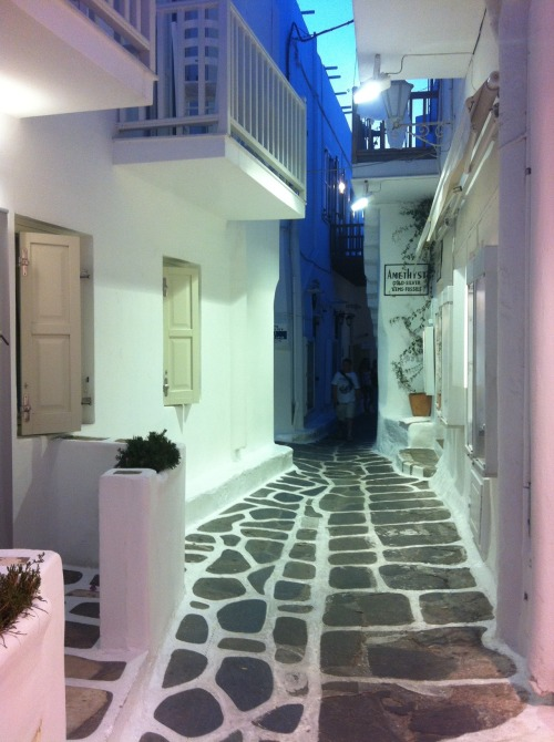 Okay, I've decided to post a little Mykonos :-) I visited Mykonos right after Santorini, the same day, in fact. So we spent the day in Santorini and the evening in Mykonos. It was possibly the best day of my life. I really didn't think I could find myself in a cooler place than Santorini until I stumbled into Mykonos. It was a fairytale. All the streets and pavements and houses and boutiques and restaurants were white. There were windmills everywhere. Everyone was very relaxed. Good vibes everywhere. Night clubs getting ready for the night, etc. I simply loved it.