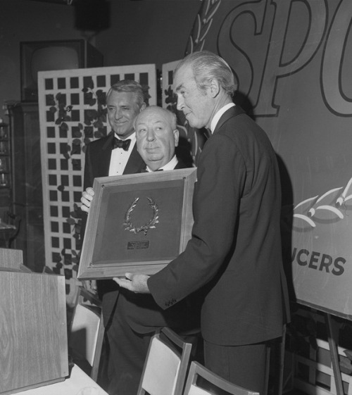 oldhollywood:  Cary Grant and James Stewart present Alfred Hitchcock with a Screen Producers Guild Milestone Award, as all three sport facial expressions worthy of any diabolical Hitchcock villain (1965) (AP)