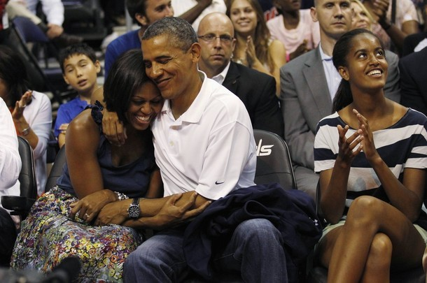 apsies:  Barack and Michelle's kiss cam moment. Adorable.