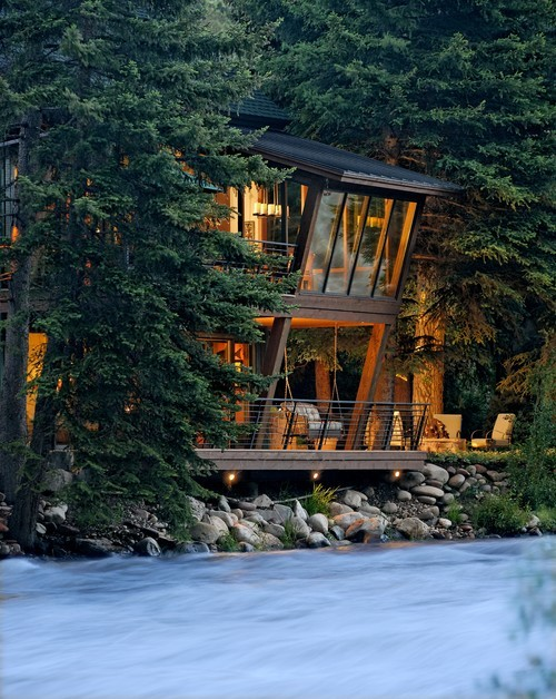 River house with lantern glow in Aspen. David Johnson Architects and 186 Lighting Design Group.