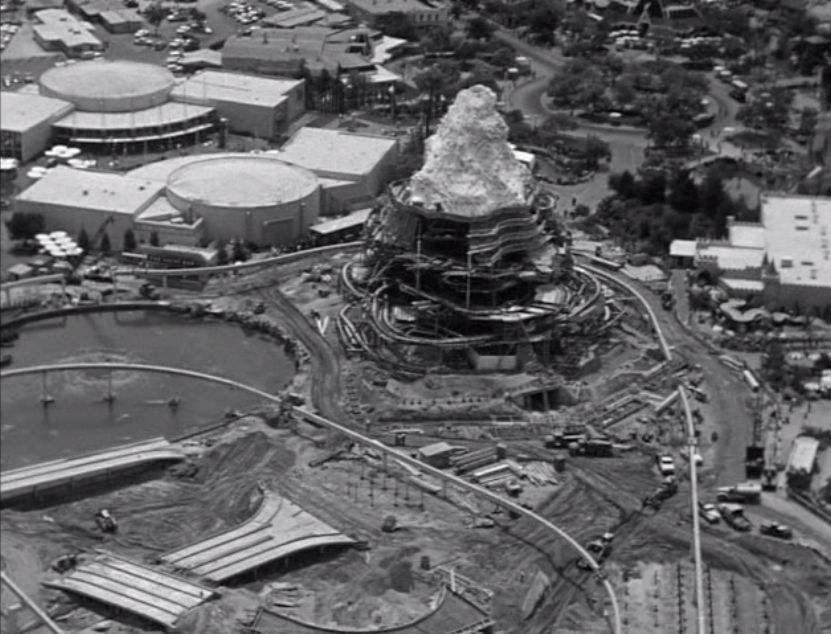 Disneyland '59, 1959 Aerial view of the Matterhorn, Monorail and updated Autopia under construction.