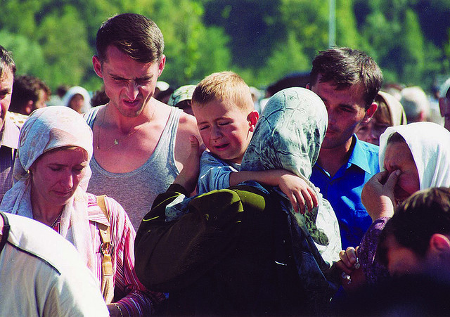 #Srebrenica before :The photo developed in September 2003 in the Bosnian Srebrenica. Former president Bill Clinton at the memorial place of Srebrenica. It is to remind and remind of the crime of Srebrenica. On this day 108 identified  bodies were buried. All rights reserved by FraMe.Photo