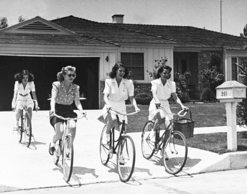 Rita Hayworth leaving her house with friends. 1940