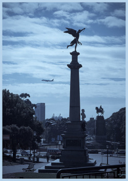 Buenos Aires - La Recoleta-0771 by Jeannot56 on Flickr.Via Flickr: I measured mainly the backlight in order to get a silhouette. PP: Lightroom 3: highlight recovery, desaturation, adding a hint of blue to the highlights and a hint of violet to the shadows. PSE7: creating border.