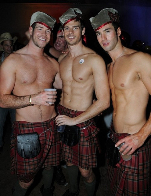 Shirtless men in kilts.