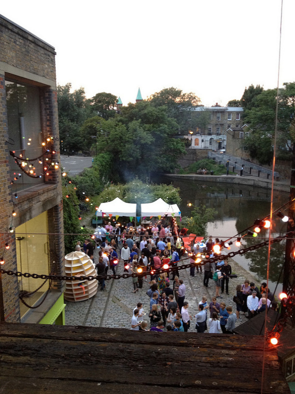 Some belated photos of the amazing Made by Many Summer party from July the 5th! A super fun night.    Cooking with Nicki on the day of the party.     Just before the party started, sun was shining and office looking beautiful with lights hanging from the ceiling.   The beginning of the night!    Amazing balloon woman made us amazing balloons.   Rob and his alien hat.   Me and Kirsty got matching balloon bracelets for our dresses.   Chris wearing the Alien hat!  Inside the Picle booth!  The view outside at the end of the night.  The end of the night…