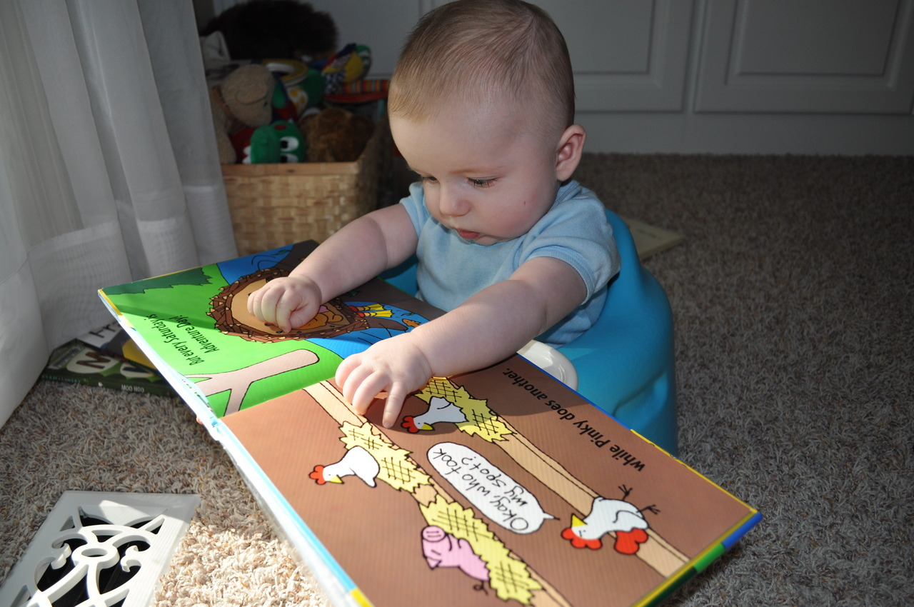 James K. (5 months) sent along this photo of himself reading BEST BUDS. Happy Adventure Day, James!