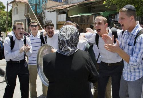 Settlers make fun of the Palestinian woman after the occupation authorities force her out of her home in the Sheikh Jarrah neighborhood in Jerusalem.