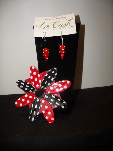 This is a pin set . A large lapel pin with matching earrings.