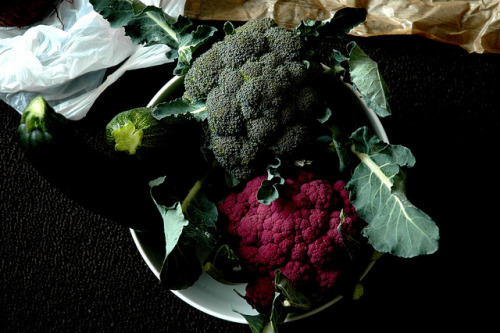 Local Organic Broccoli + Purple Cauliflower.  We eat organic foods to protect our bodies and the environment from pesticides. Pesticides hurt our organism and destroy natural ecosystem.