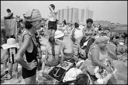 Coney Island, 1977. Crowds of people clustered together on the beach. photo by Bruce Gilden
