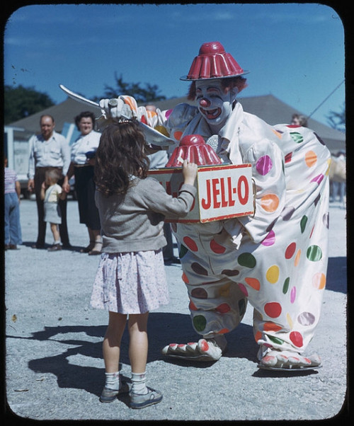 thepieshops:  JELL-OH MY GOD! Clown Felix Adler feeds Jell-o to Curly-locks Ringling Circus, 1949 Photo by Charles Cushman