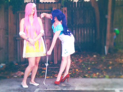 so…cosplay! here's myself as Rarity measuring Fluttershy with perv!Spike in the background. this photo is from last halloween's pony group and has just been sitting on my laptop waiting to see the world. i belieeeve the original was taken by egriz, with minor hipster editing by me. i hope it's okay to post it here; i always found this one too cute not to share.