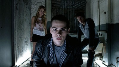 "Teen Wolf ""Raving"" Recap 7/16/2012 On this week's episode of Teen Wolf, everyone went to a rave where some got drugged (unsurprising) and others murdered (more surprising) and a vaporizer has never been so scary. It was a big, dramatic, action packed episode in which the Argents got scarier and crazier than usual. Allison's therapy bills are going to be through the roof, considering her family tries to murder her boyfriend on a fairly consistent basis. But hey, at least they have a weapon of choice: the car! Last season, Allison found out about Scott's true wolfy nature when Papa Argent tried to run him over with a car. This week, it's Mama Argent wielding first the car and then the vaporizer of death. Why must Scott die? Because Mama Argent has finally seen proof with her own crazy eyes that Allison and Scott are still together   We've seen a lot of freaky, disturbing things on Teen Wolf this season. A snake literally popped out of Jackson's eye! Somehow though, Mama Argent's evil eyes were scarier than snakes bursting out of people's faces. Such is the power of Mama Argent's crazy Nicolas Cage face. In a family that does father-daughter bonding time at the morgue, Mama Argent still strikes me as the most unhinged of the group. After the hit and kidnap, Mama Argent fills a vaporizer full of wolfsbane in order to kill Scott and make it look like an asthma attack. Unfortunately, Mama Argent falls victim to the oldest super villain trope in the book: she starts monologuing. She calls Scott stupid for being a lone wolf omega which is the exact moment Scott remembers that he actually has a pack now. A surly, attractive, impressively eyebrow'd pack who just wants to be bros. Derek rushes to the rescue and his brief skirmish with Mama Argent leads to the most shocking moment of the episode. As she falls into Papa Argent's arms (did we always know his name was Chris?) it's revealed she has been bitten. Good God, the only way Mama Argent could possibly be more terrifying is if she was also a murderous supernatural creature. Hide your wife and hide your kids Beacon Hills, because Mama Argent is going to sharpen some pencils and then probably kill everyone. In somehow less terrifying portions of the episode, Jackson is still wandering around as a walking meat puppet with chiseled cheekbones. The Kanima seems to have full control of him now, even when he's in his normal form. I can tell it's not really Jackson holding the reins because he doesn't take his shirt off once this episode. —Read the full recap including more information about the Kanima at HaveUHeard.net HERE!"