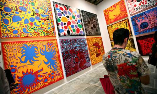 "[Article of Interest] Vivid Hallucinations From a Fragile LifeYayoi Kusama at Whitney Museum of American ArtAs any account of that career will tell you, including those Ms. Kusama gives, crisis mode was the source of her art. She was born in the city of Matsumoto, a few hundred miles northwest of Tokyo, to an affluent family that owned a large plant nursery and seed farm. Her father, by her account, was distant, cool and a serial philanderer; her mother, embittered by marriage, was perversely abusive.For whatever reason, she had hallucinations from a young age. She claimed that flowers spoke to her; that fabric patterns came to life, multiplied endlessly and threatened to engulf and expunge her. These neurotic fears were compounded by the grueling realities of World War II, when she was in her teens and had begun drawing and painting with ferocious concentration, clinging to art as a lifeline.Her grip on it was more than firm: it was unrelenting and propulsive. With a boldness unusual in a young woman of her day, she left home, under a cloud of disapproval, for art school in Kyoto. There she customized academic styles to her own subversive ends. In the show's earliest painting, ""Lingering Dream"" from 1949, she translates the traditional theme of a floral still life into a nightmare of withered limbs and vaginas dentata set in a blasted landscape."