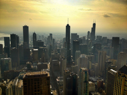 A hazy sun rises over Chicago (by @ThetaState)