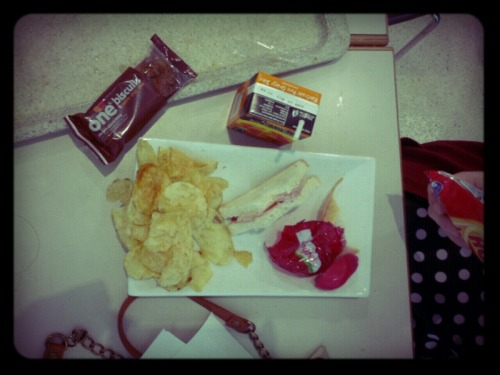 Ham sandwich…crisps…babybell…chocolate biscuit…carton of orange!