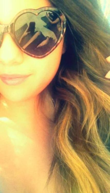 Selena wearing sunglasses from her own Dream Out Loud line.
